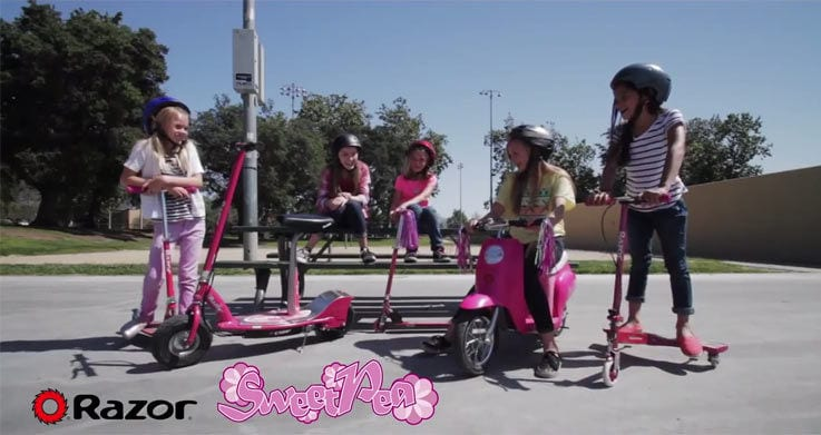 A group of girls riding electric scooters